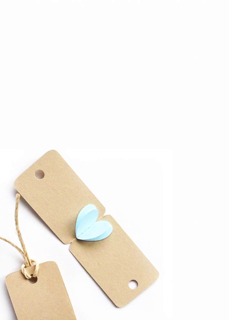 Create your own 3d Mini Heart Tags with this tutorial using the Silhouette CAMEO and paper hearts. These tags are so adorable, you may just keep them! Click through to make your own on Maritza Lisa