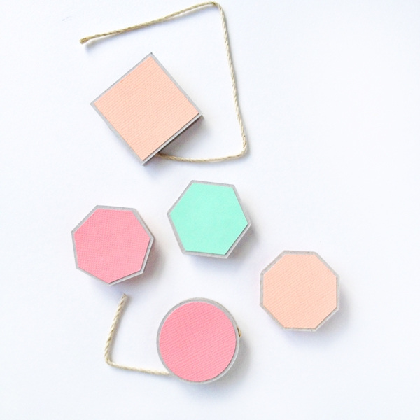 DIY Geometric Spools on Maritza Lisa - create these little spools with your Silhouette Cutting Machine. These are great for all your string, twine and ribbon storage!