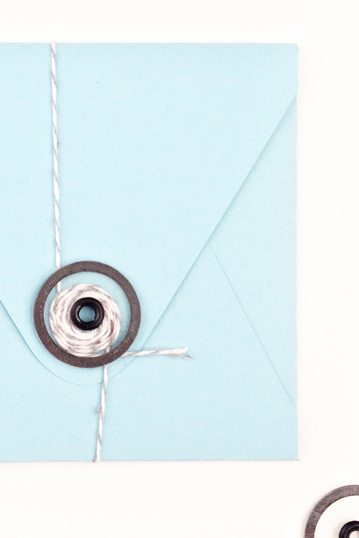 DIY Stationery: This tutorial shows you how you can create and add your own transparent button and string closures to your pretty envelopes. Click through to make your own on Maritza Lisa!
