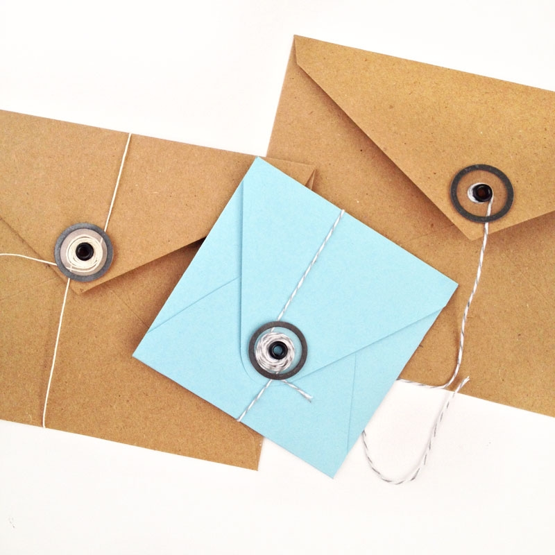 DIY Stationery: This tutorial shows you how you can create and add your own transparent button and string closures to your pretty envelopes