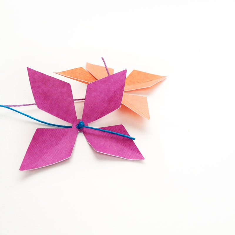 DIY Paper Flowers With Diamonds - Maritza Lisa: These lovely paper flowers are perfect for your fall and winter packages, bringing pretty blooms to brighten up the seasons. Click through to see how you can make this flower with a simple diamond shape.