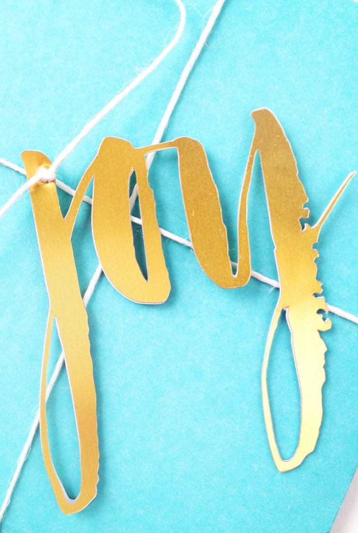 DIY Brushy Embellishments - Maritza Lisa - Take your favorite brush or script front and make your own personalized gift toppers with gold foil. Click through for the tutorial!