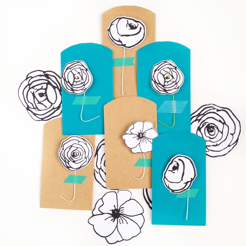 DIY Black and White Paper Flowers - Maritza Lisa: Looking for another way to wrap or present your gifts? These DIY black and white paper flowers will add a lovely touch with little effort! Use these free images and add some string - click through for the tutorial