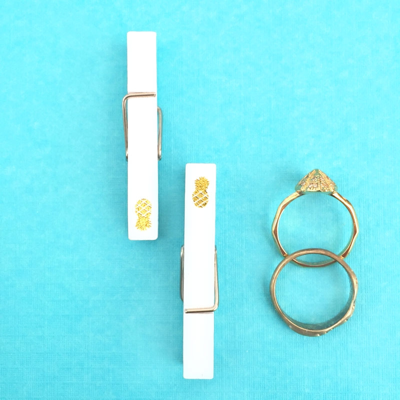 Clothespins with Gold Pineapples - Maritza Lisa: Use these gold pineapple nail decals on clothespins to make awesome desk clips or gift embellishments. Click through to make your own...