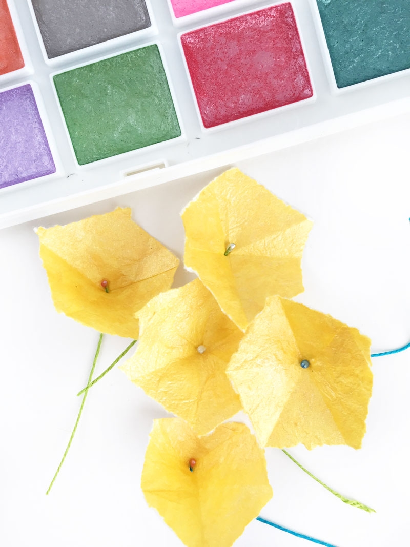 DIY Paper Flowers with Hexagons - Maritza Lisa: Create your own paper flowers with this simple shape. Click through for the tutorial...