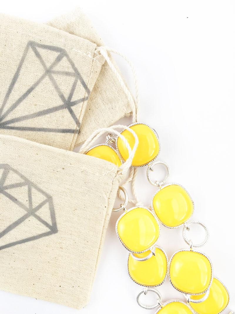 DIY Jewelry Travel Pouches - Maritza Lisa: Create your own travel pouches with this easy tutorial. Perfect for keeping your jewelry secure during vacation. Click through to make your own with  muslin bags and iron-on transfer pens...