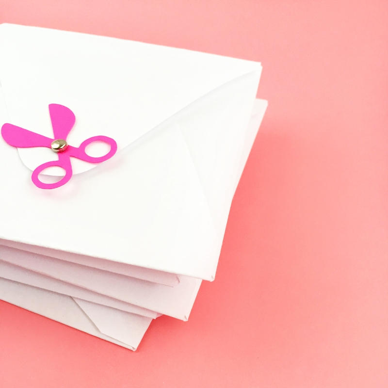 DIY Scissors Buttons On Envelopes - Maritza Lisa: Add a pair of scissors to your pretty envelopes or packages for all the crafters in your life. Grab some cardstock, a couple mini brads, fire up your Silhouette cutting machine and click through to make your own