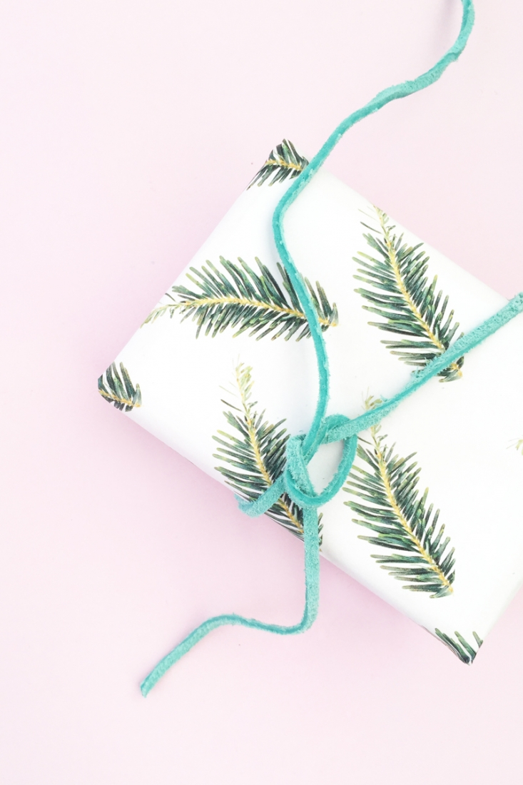 DIY Holiday Gift Wrap - Maritza Lisa: Create your own Christmas wrapping paper with leftover tree or wreath clippings. Click through to learn more!