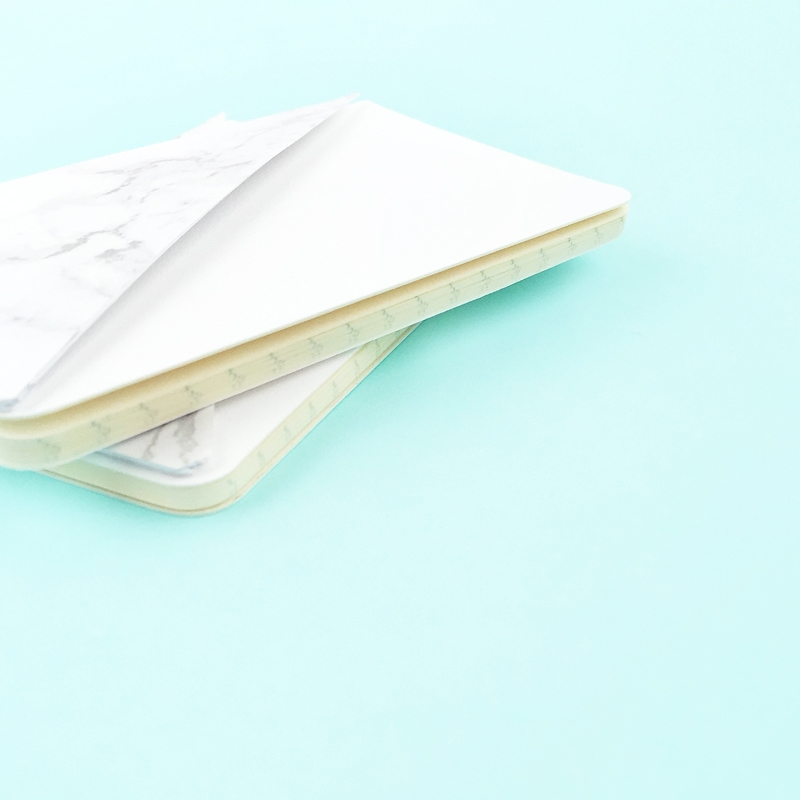 DIY Mini Journals with Marble Pockets - Maritza Lisa: Grab your marble contact paper and download this cut file or PDF to create your own mini marble pockets for your journals. Click through for the tutorial...