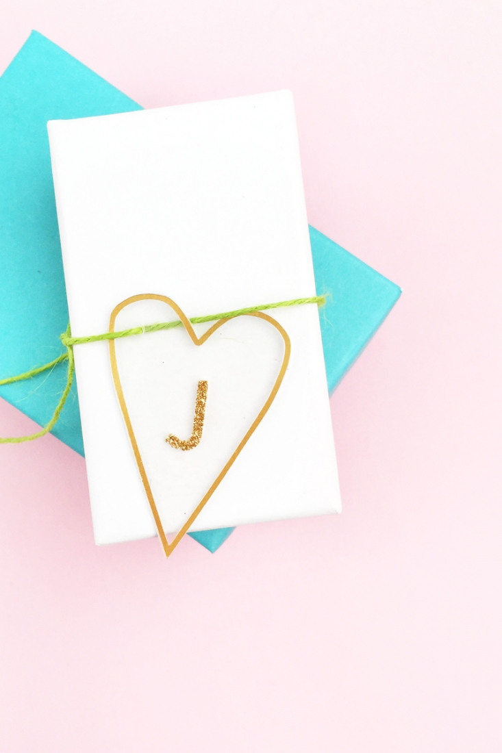 DIY Minimal Gold Heart Tags - Maritza Lisa: Create these pretty transparent heart tags with gold details for your favorite people. Click through for the tutorial...