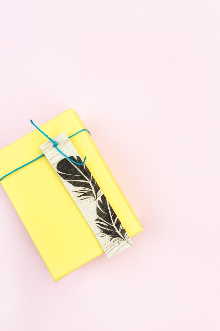 DIY Feather Wood Tags - Maritza Lisa: All you need is this free feather download, some balsa wood and printable tattoo paper to make these pretty tags. Click through for the tutorial....