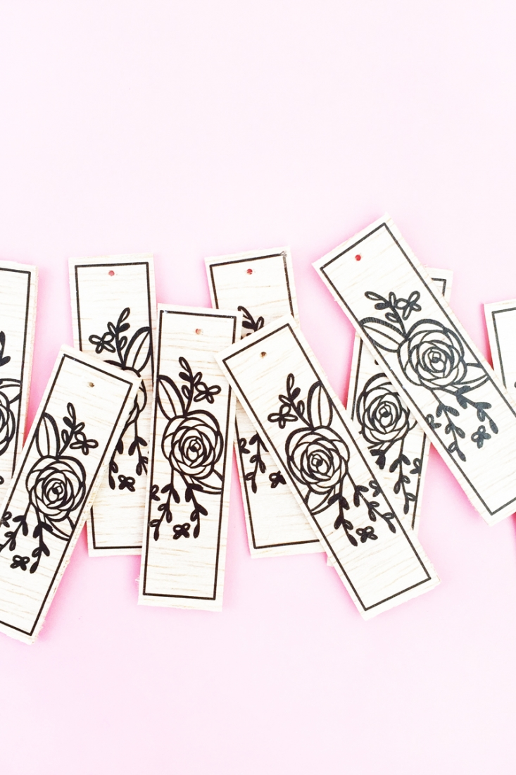 DIY Floral Wood Tags on Maritza Lisa - These floral tags were made with balsa wood, a floral image and Silhouette America's tattoo paper. Click through to make your own!