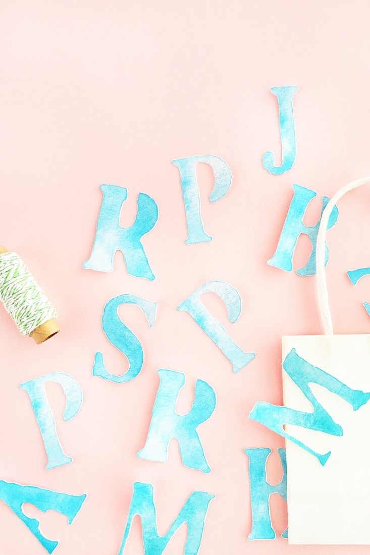 DIY Watercolor Letter Tags - Create your own watercolor letter tags for your packages, planners or memory books. Click through for the tutorial on Maritza Lisa!