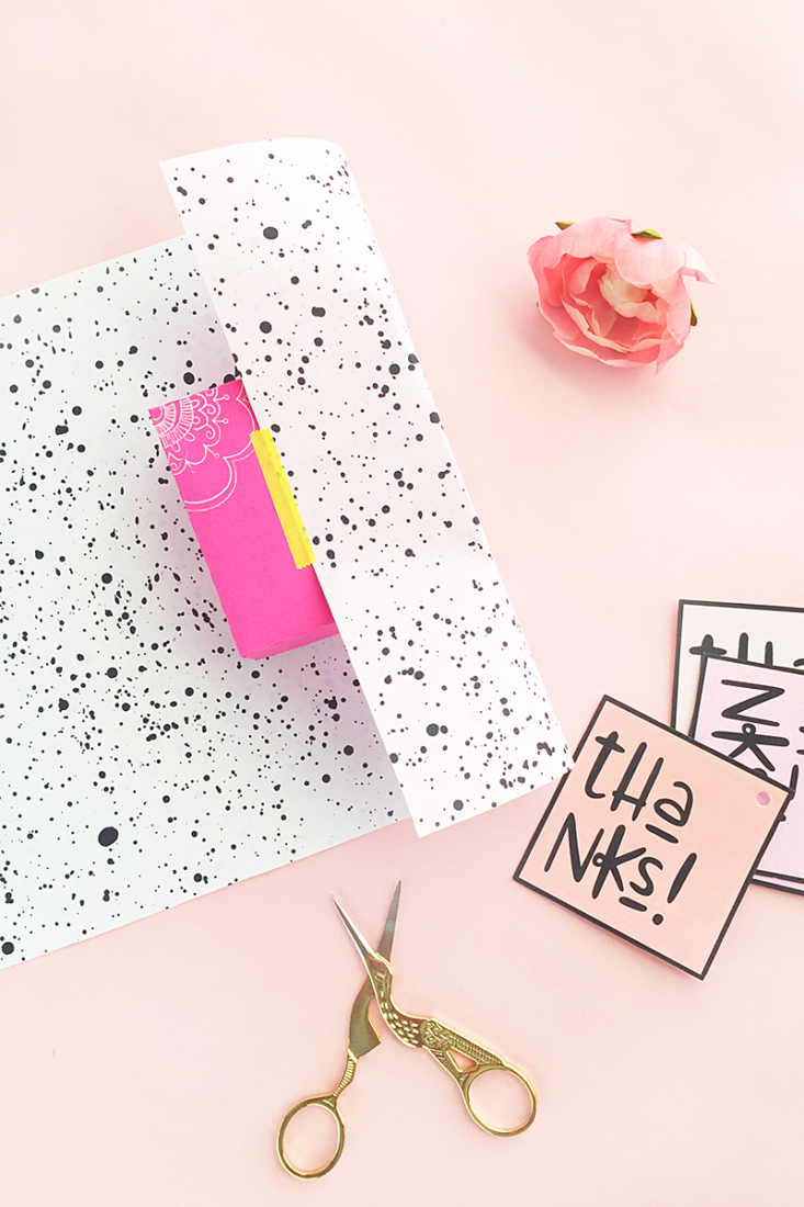 DIY Super Easy Double Sided Paint Splattered Gift Wrap - Click through to make your own double-sided gift wrap with this easy tutorial on Maritza Lisa!